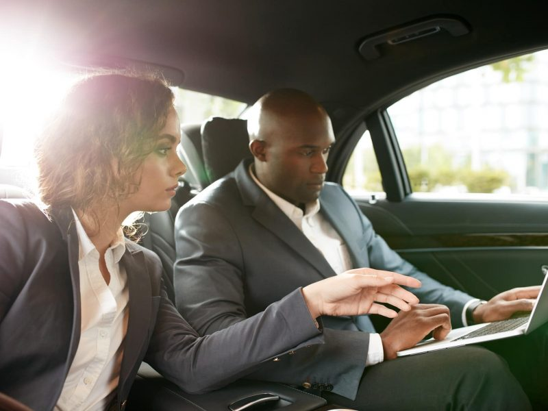 Discuss business strategy while driving to a meeting